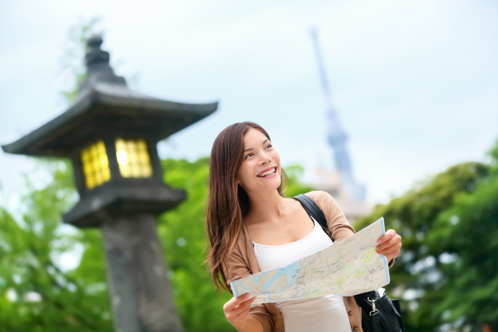 female traveller holding a map