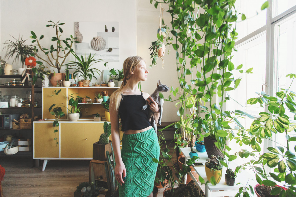 Woman with plants at home