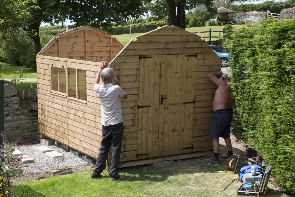 men building a small shed