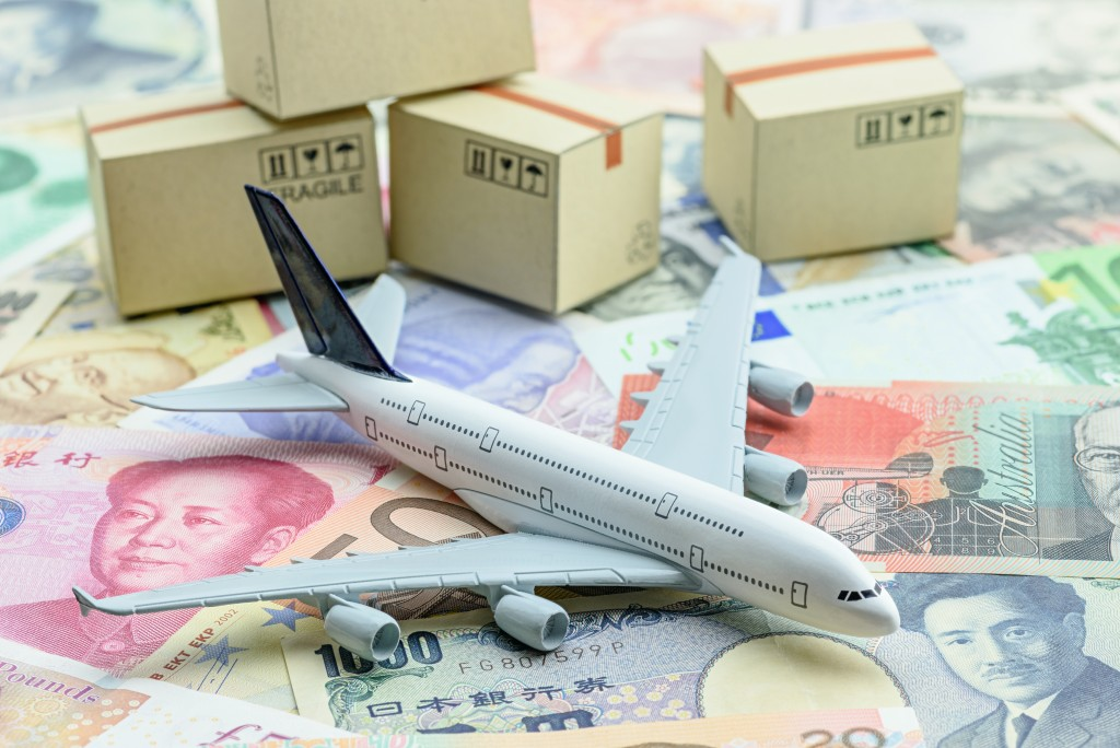airplane miniature with boxes and bills