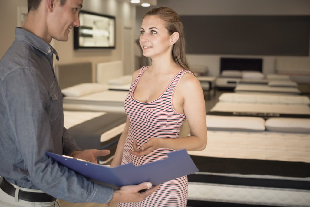 man presenting documents to a woman