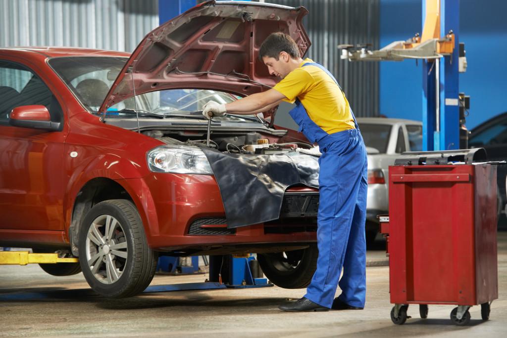 car mechanic repairing a car