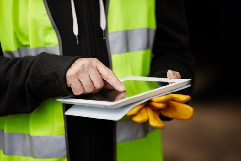 construction worker holding a gadget