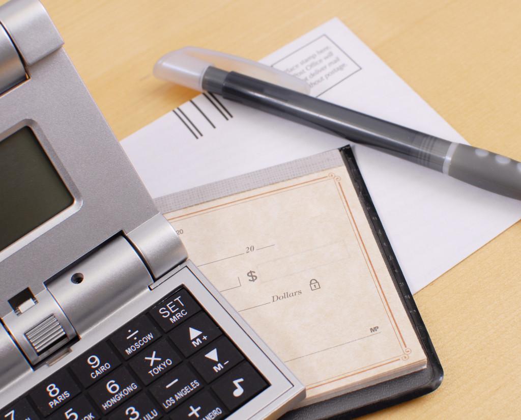 calculator, chequebook, and a pen